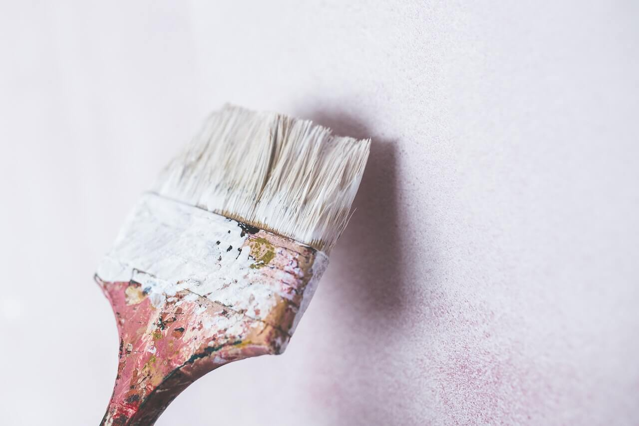 brushing paint wall white